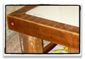 coffee table made with primitive ladder, baluster & reclaimed beam with concrete inlay panels
